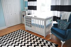 love the striped curtains with the chevron rug - but for the living room, not a nursery! ;)