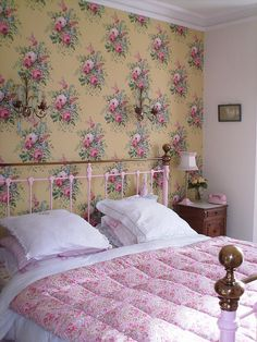 Vintage cottage floral bedroom with iron bed I am so doing wallpapper on 1 wall