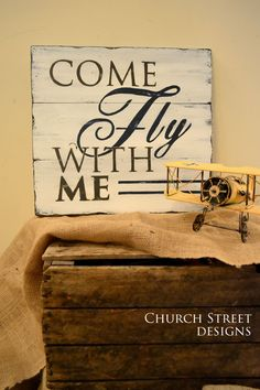 Come Fly With Me Inspire adventure and travel with this beautiful hand painted sign. This beautiful, custom, hand painted sign with bold lettering and distressed quality, makes a unique statement piece for any room. Perfect decor for an office, nursery or living room, this also makes a great gift for Christmas, weddings, anniversaries, birthdays, graduation...or just because!  ***THIS SIGN IS ALSO AVAILABLE IN A LARGER 22x24 SIZE*** https://www.etsy.com/listing/170036592&#...