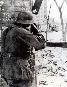 The Battle of STALINGRAD. wehrmacht soldier shooting sniping .september.1942. Stalingrad