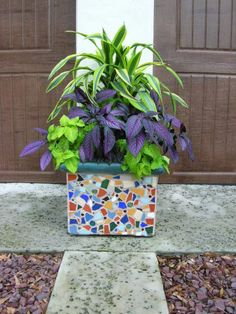 Mosaic planter -- one for the auction and one to donate to the new playground?