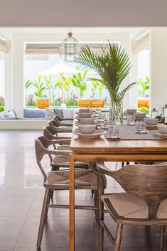 Villa JOJU- THE PERFECT FAMILY VILLA | Bali Interiors Dining Room Design, Dining Area, Dining Chairs, Dining Rooms, Bali, Fireplace Garden, Tv In Bedroom, Tropical Houses, House Made