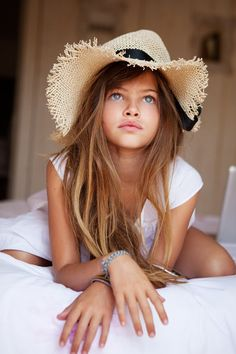she's so beautiful.. not sure if a 12 year old should be modelling but she's still so stunning