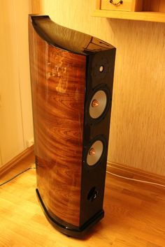 TMM Loudspeaker. stacked MDF with sapeli mahogney. 22 layes of car lacquer finish. Design: Ø.Overn / W.Sand Built by: Øyvind Overn