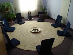 Get Relax With These Meditation Room Designs Collection : Impressive Meditation Room Design Idea with Navy Blue Folding Back Jack Meditation Chair and Round Rattan Rug also Light Blue Wall Painting
