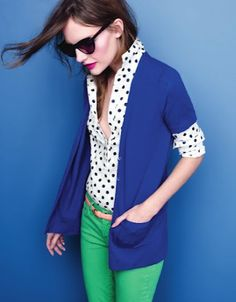 Green jeans. Black and white polka dot blouse. Blue cardigan.
