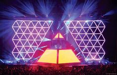 (Penton Media Inc.)  The Daft Punk Tour, Alive, uses the illuminated pyramid as the central point of the show.  I love that the pyramid is not only illuminated, but the entire show is designed to make it the central point.  The smaller arrangement of pyramids and lights hidden behind them further emphasize the pyramid.  The entire setup has a very unique appearance that makes the entire set look different from most concert sets.