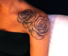 i want a rose tattoo on my shoulder :] this is my favorite!!!! think im gonna get something real similar to this.