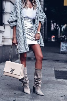 So obsessed with this neutral tone outfit - gray oversized cardigan, white camisole, silver skirt, gray Iro boots, and Louis Vuitton twist logo bag Big Fashion, New York Fashion, Fashion Trends, Style Fashion, Trendy Fashion, Fashion Outfits, Silver Skirt, Viva Luxury, Slouchy Boots