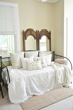 Daybed guest room. Mirrors behind bed as wall accents. Great for a rental because you don't have to hang on the wall!