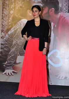 Kareena Kapoor wearing a black Theory jacket and a Michael Kors bodysuit over a long red skirt by Christopher Kane. via Voompla.com
