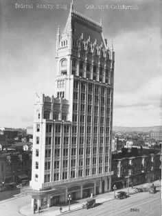 "The Federal Realty Building (now known as the Cathedral Building) in downtown Oakland (1914) Designed by Benjamin Geer McDougall, this was the first Gothic Revival style skyscraper west of the Mississippi River. It is also called the ""Wedding Cake"" for its appearance, which resembles New York's Flatiron Building. Its narrow, triangular form is a result of its location on Latham Square, where Telegraph Avenue branches off diagonally from Broadway."