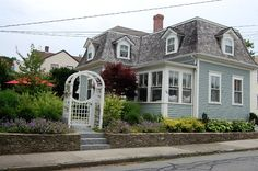 mansard roof cottage | One of my favorite parts of the exterior of their house is the arbor ...