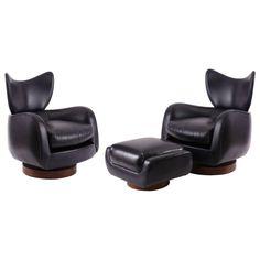 Pair of Vladimir Kagan Leather and Walnut Swivel Lounge Chairs