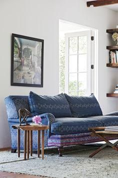 Love the indigo mixed with a vintage textile upholstered sofa.