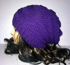 The color on this hat is just lovely! It is called eggplant which is a deep purple. That hat is made in the accordion style all the way through which gives the hat a great textured feel.  Color: Purple ( Eggplant ) Material: 100% very soft acrylic yarn Size: Adult / Teen Machine Wash - Washing and Care instructions sent with every item