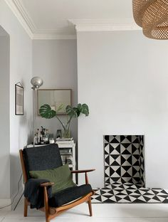 Monochrome tile fireplace - Victorian conversion - Victorian fireplace - contemporary fireplace - mid century armchair - light grey walls - 5 things I'd do differently if I did another home renovation project