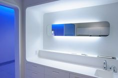 Corian healthcare cabinetry. Irvine Medical Center, CA. Part of the Philips ambient experience with tons of LED lighting.