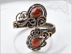 A touch of Orient faceted red jasper briolettes (12*16mm) and bronze wire (14 and 16 ga wire is wrapped with 24 ga wire).