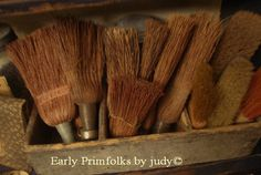 collection of dust brooms