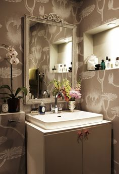 big print wallpaper in small bathrooms is classic and funky. love.