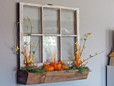 Attach a wooden box to the long side of an old window and fill with pumpkins, moss, fall flowers and berries from the craft store. Change out the floral elements seasonally for different looks. Design by Mandy Stansberry