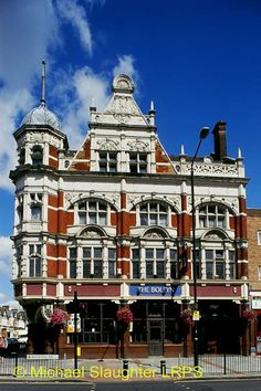 Boleyn Tavern, London, south of Upton Park tube station, East Ham; spectacular late-Victorian pub in free Renaissance style.     A spectacular billiard room with a stained glass skylight & coved frieze w/ abundant Florentine decoration.