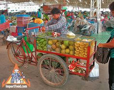 Thai Street Vendor Offers Fresh Fruit from a Bicycle Cart | ImportFood.com