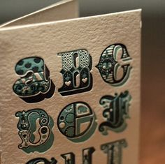 I love the intricate details on this type. Each letter has like, 2 to 3 different patterns on it. #typography