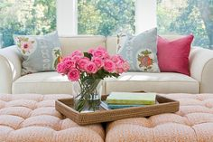 Fresh flowers and fun pillows.