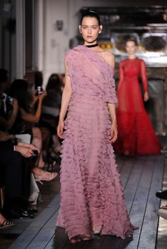 Valentino draws elegant line under French capital's couture extravaganza -Pretty in pink and ruffles.