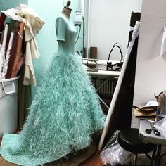 Ethereal feather gown being worked on in the studio today. Love this piece.