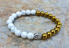 Check out this item in my Etsy shop https://www.etsy.com/uk/listing/465039851/buddha-bracelet-white-howlite-gold