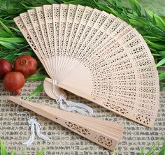 Your guests will surely appreciate these Sandalwood Fan Favors during your summertime wedding ceremony, reception or outdoor event.  Sandalwood is a uniquely fragrant wood known for its distinct color and its ability to support intricate carvings.  Each collapsible fan has an intricate carved design on its panel and a delicate white tassel attached to its handle.  Each fan comes packaged individually in a white favor box.