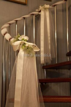 Stairwell mix of tulle, ribbon, and flowers.