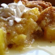 "Pineapple Crisp    ""Not your typical crisp, this one has a tropical feel. Crushed pineapple is layered with a buttery, brown sugar crumbly topping. """
