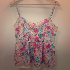 ❤️American Rag Key Hole Tank Top. Size M Super cute American Rag tank top. Has 3 buttons and an key hole in the back. Two layers: one shear white covered with floral. Had adjustable straps. Size M. Worn twice and in Great shape! American Rag Tops Tank Tops