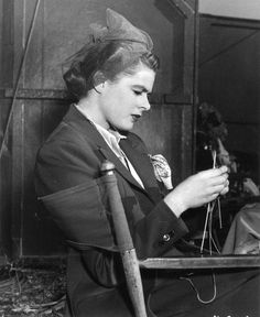 """Ingrid Bergman knitting on the set between takes, Alfred Hitchcock's """"Notorious,"""" (1946)."""