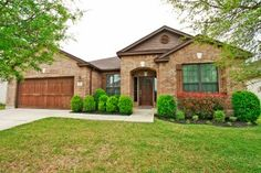 """304 Camperdown Elm Dr Austin, TX 78748   Beautiful cedar garage door and well cared for landscaping at this fabulous South Austin home! Large open living area with built-in shelving, separate study with French Doors, fantastic open kitchen with 42"""" cherry stained cabinets! See more photos and information at: http://www.goodlifeteam.com/?p=18825"""