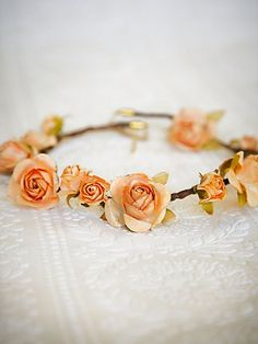 Simple crown of flowers for flower girl.  Not this color though.