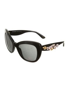 bc258f9f522 Black Dolce   Gabbana cat-eye sunglasses with grey tinted lenses and floral  accents at