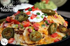 Irish Pub Style Potato Nachos. Crispy potatos loaded up with all of your favorite nachos toppings served up just the way my local Irish Pub serves them!