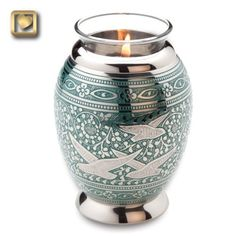 The Tealight Brass Keepsake Cremation Urn with Doves is an elegant and meaningful decorative tealight with space to hold a tiny amount (just 20 cubic inches) of cremated remains.