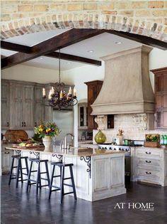 French Kitchen!!!  Backsplash, cabinetry contrast, beams, brick backsplash, brackets under island, AHHHH..... all of it.