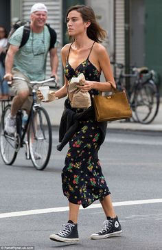 Off-duty: Wearing her hair in a stylishly messy side-parting, she also kept make-up to a m...