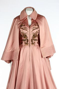 An early Jacques Fath ball gown and matching cape, probably Spring-Summer, 1948. the gown labelled 'Jacques Fath, Paris', of deep rose-pink satin, zip-fastened centre-front and with zips to both cuffs - See more at: http://kerrytaylorauctions.com/one-item/?id=81&auctionid=401#sthash.KlIZkgw3.dpuf