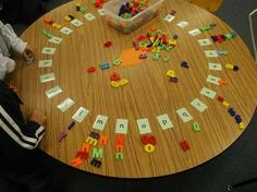 LOVE this idea!  Sort and match magnetic letters around the table.