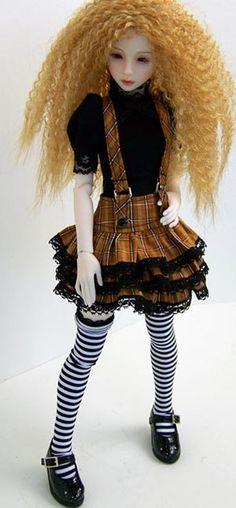 Fashion: plaid tiered skirt w suspenders, black bubble-sleeve tee.