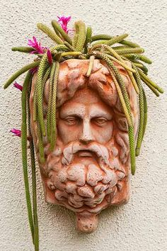A succulent hair-piece cascades from a wall-hung figural planter.| Photo: Mark Lohman | thisoldhouse.com