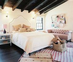 Estee Stanley, girls room, white, dark wood, light pink, layered rugs, basket, headboard, tufted sofa